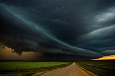 """""""This shot was taken few years ago while I was chasing in southwestern Saskatchewan. On the radar the bow echo produced by this storm was few hundreds of km long trending north-south. I followed this baby from its birth to death. Storm location is Gull Lake, Saskatchewan, Canada."""" Gunjan Sinha."""
