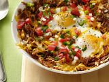 Hash Browns and Eggs, so easy!   Fry 1 cup each chopped onion and grated potato in a cast-iron skillet with butter until crisp. Add 1/2 cup grated cheddar and crack in 2 eggs. Bake at 425 degrees F until set; top with salsa.
