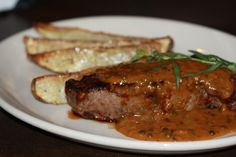 Our summer dinner specials include a Prime New York Strip with green peppercorn sauce. A big-flavored, broiled 14-ounce prime steak with brandy & tarragon & roasted Parmesan-garlic potato wedges.