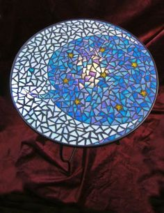 The Gypsy Moon Table  This beautiful mosaic table is a perfect accent on your porch or in your garden. Designed by Grace Santoro