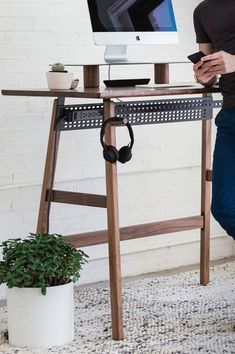 a stylish contemporary standing desk of wood and blackened steel won't spoil your space #ModernHomeDecorRetro