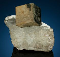 PYRITE  Mina Ampliación a Victoria, Navajún, La Rioja, Spain   Home to the best Pyrite cubes in the world is a pit about 2½ miles outside of the town of Navajún, where Pedro Ansorena Garret has been digging these stark geometric wonders since 1970, when he was granted the mining concession. This is a fine example of the type, showing an simple cubic Pyrite crystal embedded in a marl matrix ( a mixture of clay and lime) of Cretaceous age.