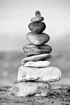 stock photo of vertical monochrome image pebbles balanced in tall stack outdoors Foto Website, Kiesel, Royalty Free Pictures, Illustration, Monochrome, Garden Sculpture, Poster, Stock Photos, Fine Art