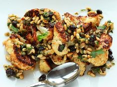 Caramelized roasted cauliflower with a pine nut, raisin, and caper vinaigrette - Serious Eats Side Dish Recipes, Vegetable Recipes, Vegetarian Recipes, Cooking Recipes, Healthy Recipes, Cauliflower Recipes, Oven Roasted Cauliflower, Cauliflower Steaks, Cauliflower Salad