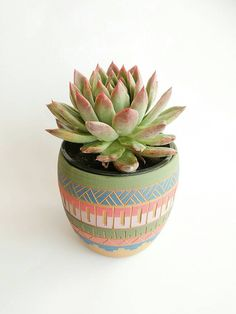One of a kind Aztec ceramic planter  I throw these vase on the wheel, then colored it with a beautifull colorfull engobs, carved Accuracy by hand and fired at a temperature of 1200 º C to ensure its durability.  Each vase get full Investment and get this unique look.  ►Contains small hole in the bottom for drainage ►you will get the planter without the succulent :)  Vase measures (cm) 12.8cm high 11.5cm opening Vase measures (inch) 5 high 4.6 opening  vase made by hand , please notice t...
