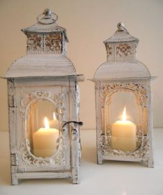 Shabby lanterns with candles Found some of these at Pier 1 <3 them!