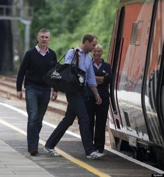 6/13/13 Prince William boards train to London.  Wow!  The future king taking the train just like one of us.  That's impressive.