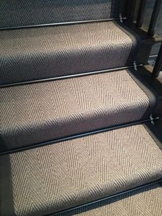 "Embedded image ""Taupe herringbone staircase runner installed in our studio love the bronze stair rods"""