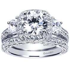This is perfection. Especially with the band ...gaaaaaaahhhhhhhh Vintage Halo 3-Stone Plus 2.35cttw Diamond Engagement Ring with Trapezoid Side Diamond