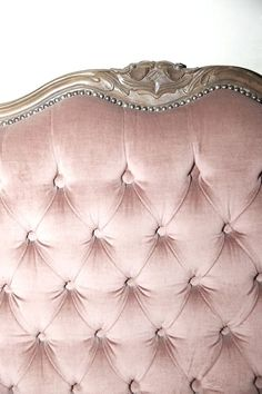 a beautiful tufted velvet headboard