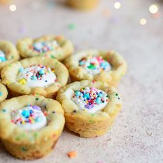 Chewy, scratch-baked birthday cookie cups studded with sprinkles and white chocolate chips and filled with frosting.