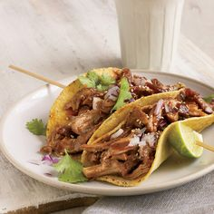 Beer Braised Turkey Tacos ~ Skinless turkey thighs and drumsticks are packed with flavor, low in fat and high in protein and essential minerals like selenium. Deborah Schneider braises the meat in beer until ultra-tender, then shreds it for tacos.