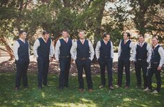 casual wedding party | blue pants and vests with a bright tie