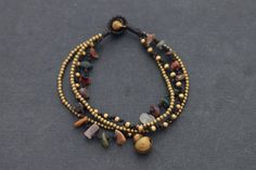 This is hand woven bracelet made with dark brown cotton waxed cord weaved together with fancy jasper stone,brass beads,chain and brass jingling bell.