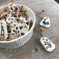 Skratch Ceramics & Ceramic Key-rings Tulips, cockerels and welsh ladies on ceramic key-chains with leather fastening. Sgraffito decorated pottery handmade by Kate Russell in Wales. The post Skratch Ceramics Sgraffito, Ceramic Jewelry, Ceramic Clay, Ceramic Pottery, Ceramic Fish, Slab Pottery, Ceramic Bowls, Ceramics Projects, Clay Projects