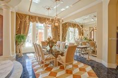 Luxury Dining Room. Marble Floors. Mirrored Walls. 3-d floor Pattern. Luxury Drapes. Interior Architectural design and details by Susan Berry Design, Inc. Location:16631 Arezo Court,Montverde, FL Square Footage: 8,879 Bedrooms & Bathrooms: 5 bedrooms & 8 bathrooms Price: $3,500,000 This Mediterranean style waterfront mansion is located at1663
