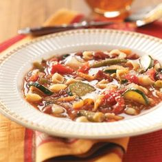 Vegetable Minestrone - 2 cans 14.5 oz. beef broth - 16 oz. can kidney beans - 15 oz. can great northern beans - 14.5 can Italian style stewed tomatoes - large onion - medium zucchini - carrot - tomato juice - dried basil - dried oregano - garlic powder - frozen cut green beans - frozen chopped spinach - small shell pasta