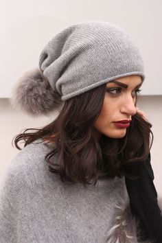 Cashmere Hat with Fox Pom Pom and whole skins. Made in Italy. Quality: 100% Cashmere Loro Piana; Color:Grey.  #cachemire #hats #furs #accessoriesfurs #belt #handmade #madeinitaly #loropiana