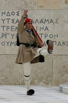 """A Greek Guard performs his """"over-the-top"""" routine at the changing of the guard ceremony outside the parliament building, Athens, Greece. Mykonos Greece, Crete Greece, Athens Greece, Zorba The Greek, Greek Soldier, Empire Ottoman, Greek Warrior, Cradle Of Civilization, Venice Travel"""