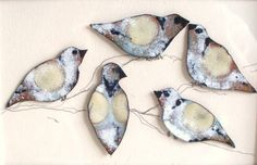 Enamelled birds waiting for a home