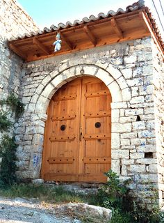 Door with doll.  Berat, Albania