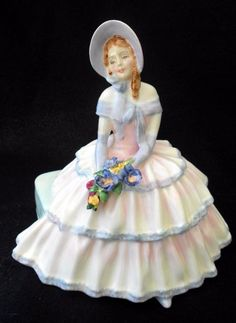 Royal Doulton Figurine 1935 DAYDREAMS HN1731 Lady sitting Holds Flower Bouquet