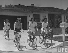 1950s cycle chic - it looks like three of these ladies are wearing nurses' uniforms, actually.
