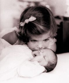 ~~Caroline Kennedy kissing baby brother John