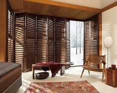 Solid wood shutters never go out of style in this natural yet refined living room design.  NewStyle® hybrid shutters ♦ Hunter Douglas window treatments