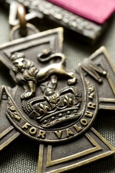 One of the best images you will find of a real Victoria Cross. Note the fine detail of the rope treading and detailed background stippling. You will find neither of these features on a reproduction.