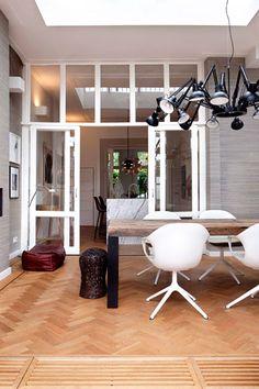 neutrals, lots of textures, funky lighting ... raw wood, white marble, steel, wrinkly linen — by Dutch interior designer Maaike van Diemen