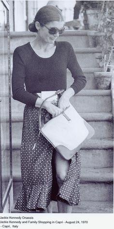 Jackie Onassis and her Gucci handbag.
