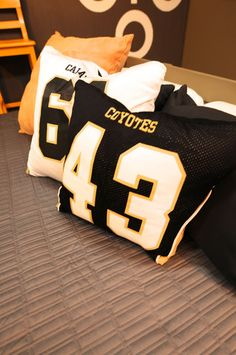 DIY sports jersey pillows... Would be good for either Christian's room or the basement gameroom!