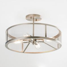 Mesh Industrial Semi Flush Mount Ceiling Light.  May not be the right finish or the right price:(  Only in Brushed Nickel.  $290.  Shades of Light