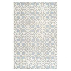 Hand-tufted wool rug with a quatrefoil tile motif.  Product: RugConstruction Material: WoolColor: Light blueFeatures:  Hand-tuftedMade in India Note: Please be aware that actual colors may vary from those shown on your screen. Accent rugs may also not show the entire pattern that the corresponding area rugs have.Cleaning and Care: Professional cleaning recommended