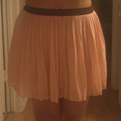 Super cute pleaded pink skirt Pleaded pink skirt - a little wrinkled in the photo, sorry! Makes me feel ballerina-like when I wear it. So cute! Black waistband is elastic. 100% polyester. Rarely worn. Light pink. Large, but fits like a size 6. Forever 21 Skirts