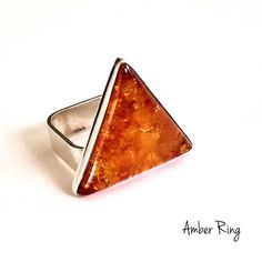 Amber Statement Ring Beautiful Amber is handcrafted by artisans in Poland. Using natural Amber stone.                                                                                                  •Solid .925 Sterling silver                                       •Excellent Quality Handmade in Poland•  This ring is sure to be a special gift to be enjoyed! Packaged in a lovely Bag!               BRAN NEW WITH TAG SAME DAY OR NEXT DAY SHIPPING  BUNDLE TO SAVE Jewelry Rings