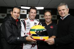 (L-R) Helio Castroneves, Simon Pagenaud, Tony Kanaan, and Gil de Ferran with the Ayrton Senna design helmet that Pagenaud will wear during the Indy 500 race. (Photo: LAT Photographic)