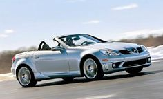 Mercedes 55 SLK AMG Hard top Convertible. Greg & I looked at one today. But it was black, & it didn't matter how good the price was, he'll never buy a black car for me. But man it was so COOL sitting behind the wheel. Still car-searching...♥