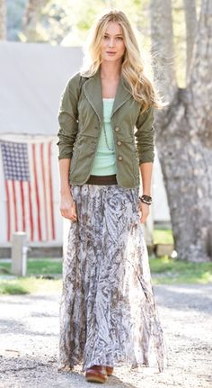 Combination of long skirt, t, jacket, boots, and necklace.