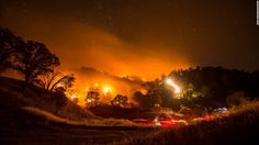 """This long-exposure photo shows a backfire that was set to stop the Rocky Fire near Clearlake Oaks, California, on Monday, August 3. The Rocky Fire is just one of <a href=""""http://www.cnn.com/2015/08/05/us/california-wildfires/"""" target=""""_blank"""">24 wildfires spread across the state</a> in a worse-than-average wildfire season."""