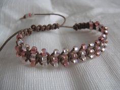 Mixed pink Shamballa .. instead of a big bead looks like 6/0 beads