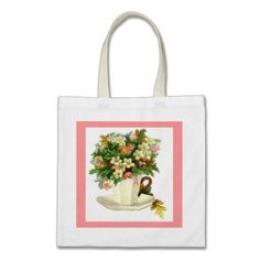 Vintage white teacup with flowers tote. http://www.zazzle.com/littlethingsdesigns