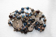 St. Cecilia Catholic Rosary-Blue Gold Quartz, Garnet, and Solid Bronze--Semi Precious--St. Cecilia Handmade--Catholic Rosary--Free Shipping by comeHSrosaries on Etsy https://www.etsy.com/listing/600692623/st-cecilia-catholic-rosary-blue-gold