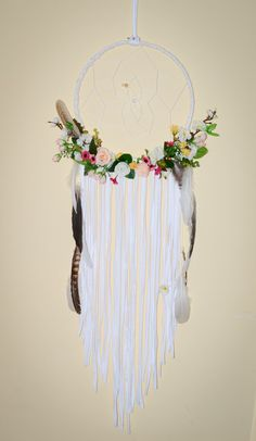 Big lovely soft flowers dream catcher! Bohemian dream catchers - custom made, every one is unique.  This dream catcher is so full, romantic and bohemian that will decorate any home place! Charming big dream catcher with lots of white lace, soft colors flowers, natural feathers and crystal beads. This dream catcher is available in three different sizes: 6 inch base, 8 inch base or 12 inch base.  Dream catchers are a great gift for any occasion or a great way to decorate your own home. Hang…