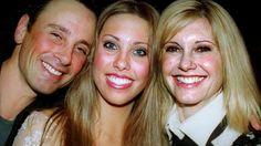 Chloe with dad Matt Lattanzi and mum Olivia Newton John in 2002.