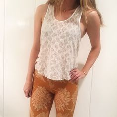 We the Free Lace Tank Purchased from Nordstrom. In good condition! Has an orange stripe running down the back that snaps closed. There is also a little lace pocket on the front side #wethefree #freepeople #cream #lace #top #tops Free People Tops Tank Tops