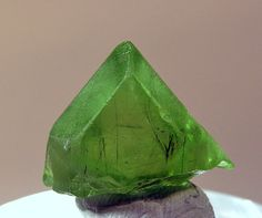 Forsterite (Var: Peridot), Mg2SiO4, Ludwigite, Mg2Fe3+(BO3)O2, Sapat Gali, Naran, Kaghan Valley, Mansehra District, Khyber Pakhtunkhwa, Pakistan.  Dimensions: 2.1 x 1.6 x 1.4 cm. Gem quality peridot crystal with sharp faces and excellent color. Copyright: © Edwards Minerals
