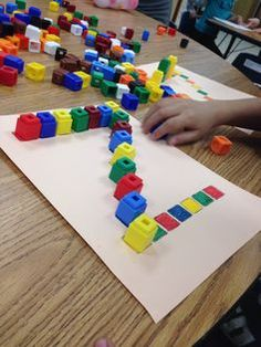 Color recognition, learning patterns, and making letters with unifix cubes. Pre-K literacy or math center Color recognition, learning patterns, and making letters with unifix cubes. Pre-K literacy or math center activity