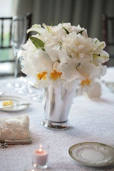 white flowers, hint of yellow in julep glasses